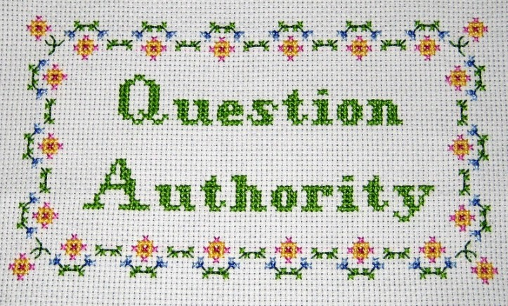 "Cross-stitch with the words ""question authority"""